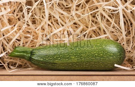 Bright raw vegetables over sawdust background in the wooden box