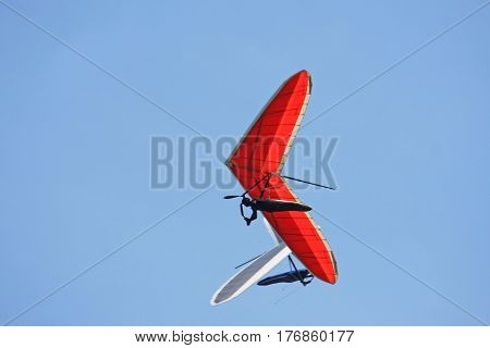 Hang gliders flying in a blue sky