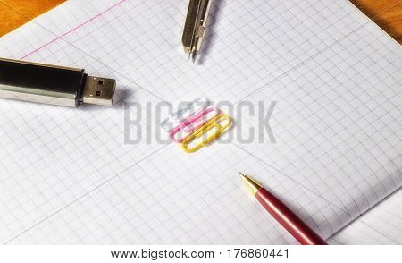 Office for business a pen for signing documents a flash drive for storing the necessary information very convenient and compact paper clips for fastening documents and invoices compasses