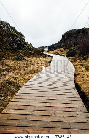 Winding wooden pathway into the nowhere, Iceland.