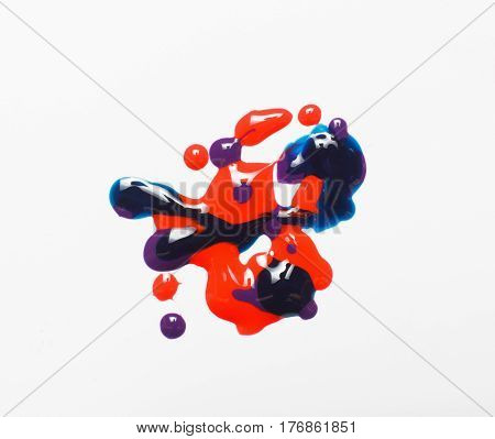 Creative painting, abstract modern art. Shiny texture of smeared red, blue and purple color nail polish isolated on white background. Creativity, abstractionism.