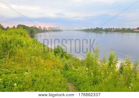 View of Neva river and microdistrict Ribatskoe on the outskirts of St. Petersburg at sunset Russia.