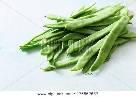A pile of fresh green beans on table. Green runner beans.