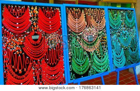 Postojna, Slovenia - May 9, 2014: Lot of colored beads from different minerals and stone background at souvenir shop at Postojna, Slovenia on May 9, 2014: