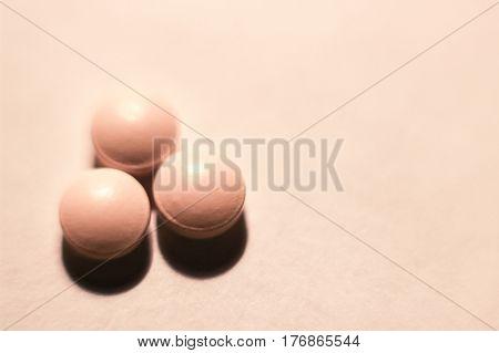 three pills, three pills on white background