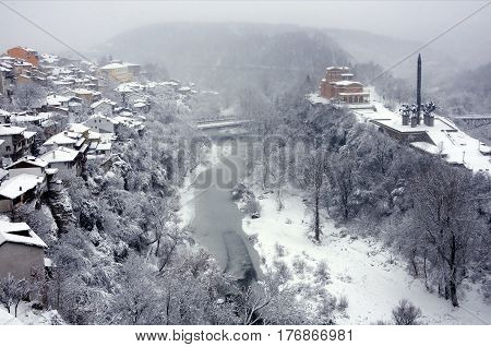 VELIKO TARNOVO BULGARIA - JANUARY 6 2017: The Yantra river residential area and the monument of the Assens in the winter