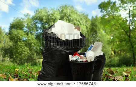Full Black Wastebasket And Plastic Bags