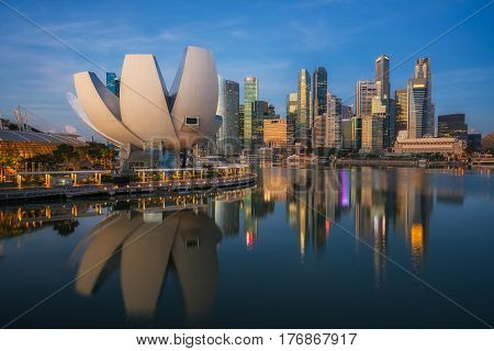 Cityscape of Singapore city in morning sunrise with business building center background.