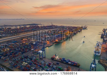 Logistic port hub vessel transportation and import export business with boat and crane