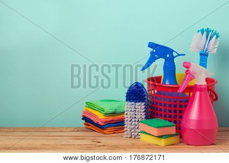 Spring cleaning concept with supplles on wooden table