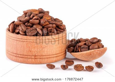 coffee beans in a wooden bowl with scoop isolated on white background.