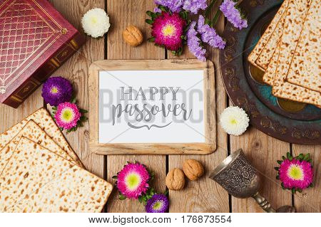 Jewish holiday Passover background with photo frame matza and seder plate. View from above