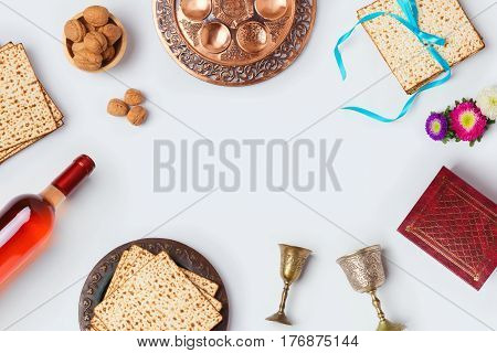 Jewish holiday Passover background with wine matza and seder plate. View from above. Flat lay