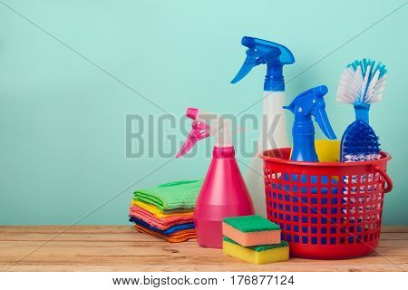 Office cleaning concept with supplles over mint background