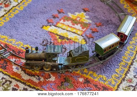 Old iron train toy on the carpet
