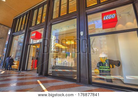 MILAN, ITALY- MARCH 7, 2017: the famous constructions toy bricks, Lego Store of Milano. Storefront in Piazza San Babila square at the end of Corso Vittorio Emanuele II from Piazza Duomo square.