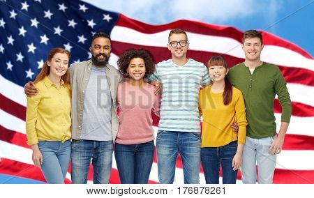 diversity, race, ethnicity and people concept - international group of happy smiling men and women over american flag background