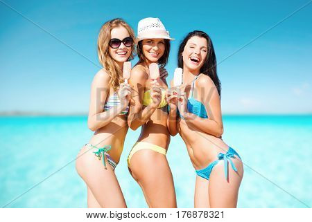 summer holidays, vacation, food, travel and people concept - group of smiling young women eating ice cream on beach over sea and blue sky background
