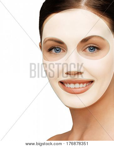beauty, cosmetology, hydration, people and rejuvenation concept - close up of beautiful young woman with collagen facial mask over white background