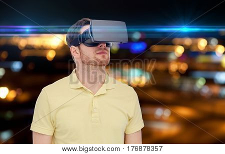 technology, augmented reality, entertainment and people concept - young man with virtual headset or 3d glasses over night lights background