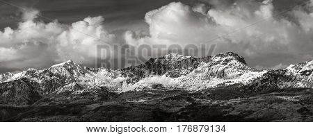 Snow covered Piolit and Parias mountain peaks (Black & White). Winter in Hautes Alpes Southern French Alps France