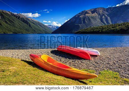 kayaks and mountain lake, location - Nelson Lakes National Park, South Island, New Zealand