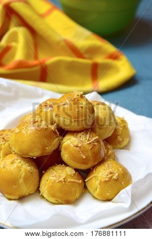 Nastar or Indonesian pineapple tart cookies topped with grated cheese
