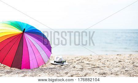 Beach colorfull umbrella on a sunny day sea in background select and soft focus
