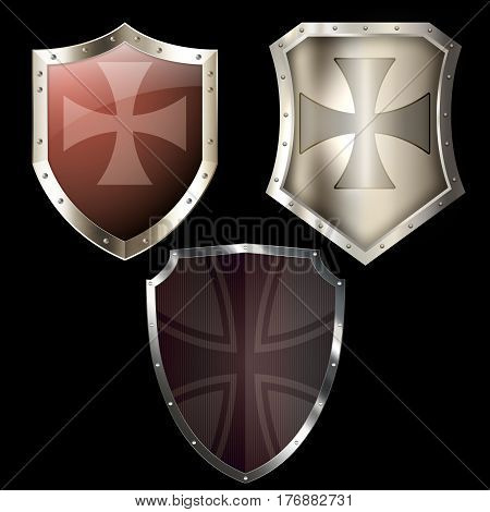Medieval shields with maltese cross and riveted border. Isolated ob black background.