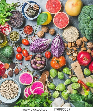 Clean eating concept over grey concrete background, top view. Vegetables, fruit, seeds, cereals, beans, spices, superfoods, herbs for vegan, gluten free, allergy-friendly weight loosing or raw diet poster