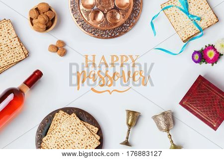 Jewish holiday Passover Pesah greeting card with wine matza and seder plate. View from above. Flat lay