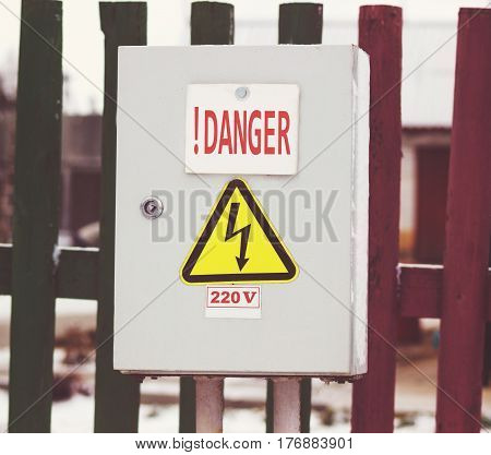 Switch control panel 220 volt danger. A warning