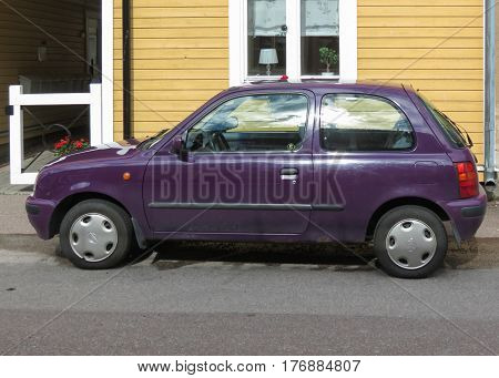 Maroon Nissan Micra