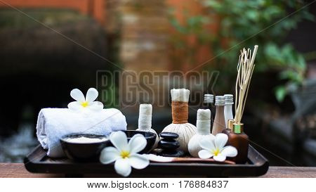 Spa massage compress balls herbal ball on the wooden with treaments spa Thailand select focus