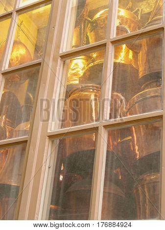 ram kitchenware stored behind a wooden window