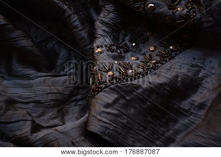 silk chocolate color with embroidery, texture of the fabric