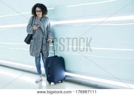 Girl Ready To Go On Vacation Using Travel App