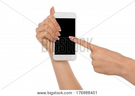 Closeup of a woman touching mobile phone display, female hand holding modern smartphone and pointing with index finger on blank screen, white isolated background, copy space, cutout