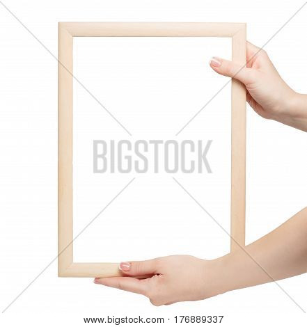 woman manicured hand holding a wooden frame on white background. mockup concept. french nails