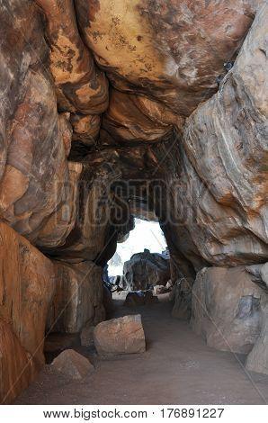 Bhimbetka rock shelters, Madhya Pradesh, India- January 22, 2016:, Madhya Pradesh, India- January 22, 2016: Entrance to the Auditorium Cave with prehistoric rock paintings at Bhimbetka UNESCO World Heritage site Raisen, Madhya Pradesh, India.