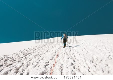 Man climbing in mountains glacier Travel Lifestyle endurance concept adventure active vacations outdoor mountaineering sport