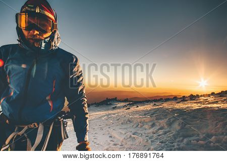 Man alpinist climbing in mountains Travel Lifestyle concept adventure active vacations outdoor greet the dawn epic moments
