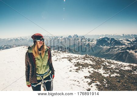Woman climber reached Elbrus mountain summit Travel Lifestyle success concept adventure active vacations outdoor happy emotions enjoying peaks range landscape
