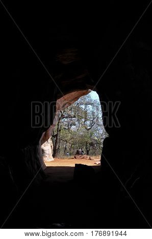 Bhimbetka rock shelters, Madhya Pradesh, India- January 22, 2016: Darkness inside the Auditorium Cave and prehistoric paintings on its wall at Bhimbetka UNESCO World Heritage site Raisen, Madhya Pradesh, India.