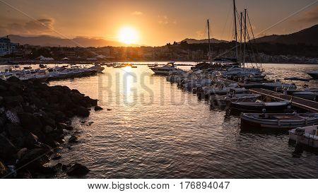Boats Mooring In Giardini Naxos Town On Sundown
