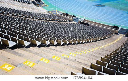 empty tribune of big sport stadium with plastic chairs