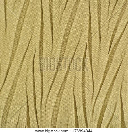 Yellow Golden Crumpled Synthetic textile Creased Polyester Fabric Detail Vertical Decorative Wrinkled Texture Pattern Bright Large Detailed Textured Swatch Background Gentle Bokeh Accents
