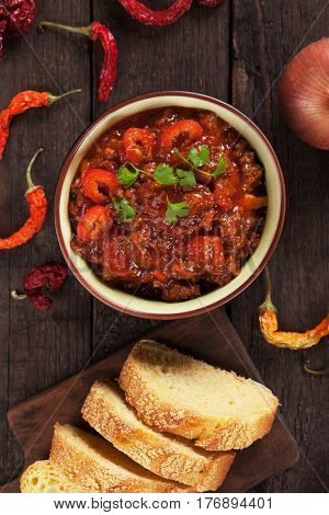 Chili con carne, mexican stew with ground beef, tomato and hot chili peppers
