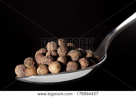 Spoon With Pile Of Allspice, Jamaica Pepper Or Pimenta