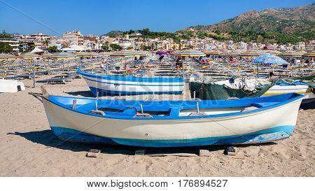 People And Boats On Urban Beach In Giardini Naxos